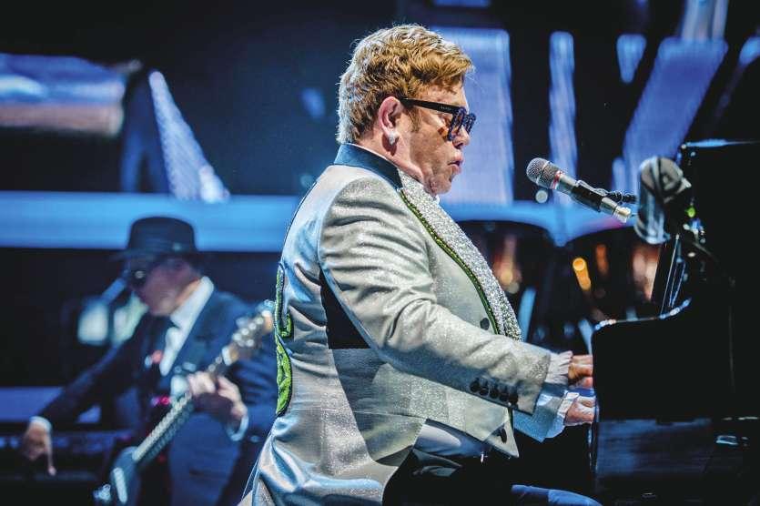 Le chanteur-compositeur anglais Elton John sur scène lors du Farewell Yellow Brick Road-Tour dans le Dôme Ziggo à Amsterdam le 8 juin dernier.Photo Ferdy Damman/AFP