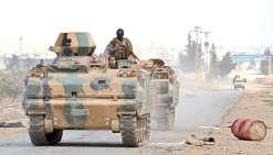 Turcs et rebelles prennent un fief de l'EI
