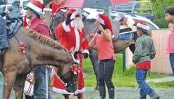 Le père Noël arrive  à cheval