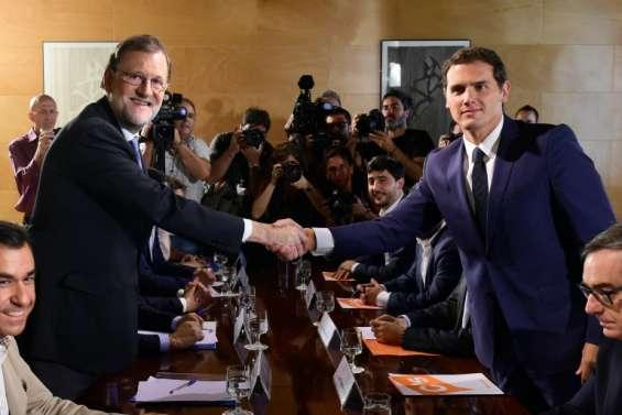 Espagne: Rajoy s'assure du soutien des libéraux