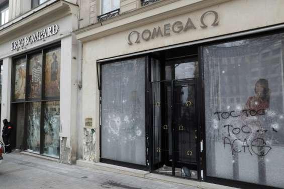 Saccage des Champs-Elysées: 80 enseignes touchées, le Premier ministre interpellé