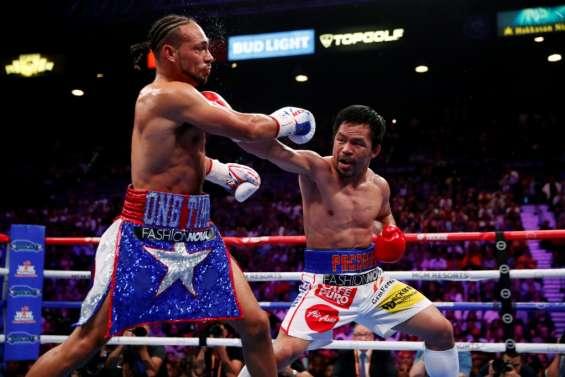 Boxe: Pacquiao surpasse Thurman et s'empare de la couronne WBA des welters