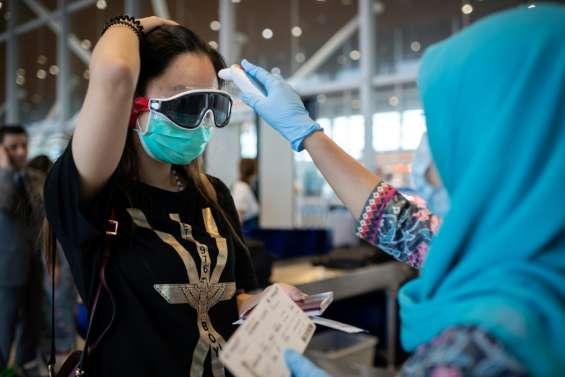 Coronavirus: près de 1.900 morts, l'OMS contre toute mesure disproportionnée