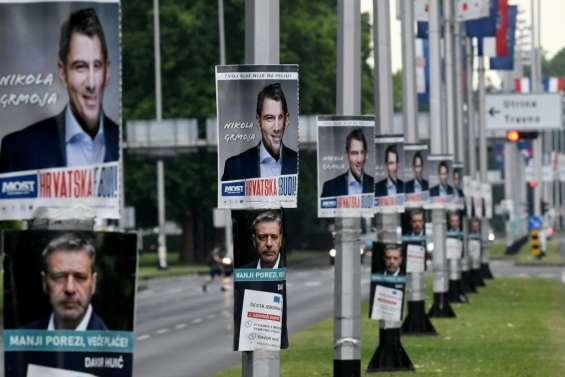 Les Croates votent à des législatives serrées dans l'ombre du virus
