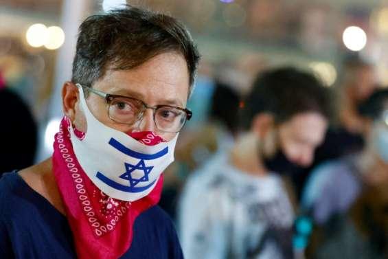 Covid-19: Israël reconfine, des pays européens durcissent les mesures sanitaires