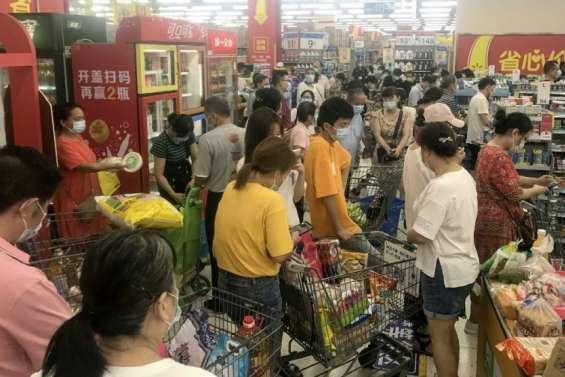 Chine: un an et demi après, Wuhan rattrapée par le Covid
