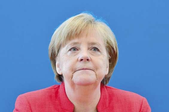 Migrants : Merkel prise en tenailles
