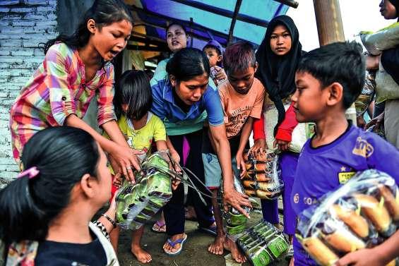 Les survivants du tsunami manquent de tout